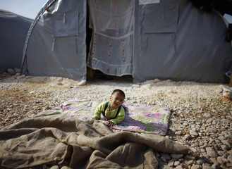 A Kurdish refugee baby from Kobani is seen in a refugee camp in Suruc
