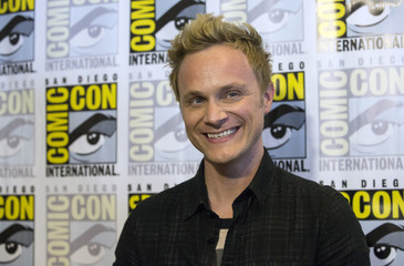 "Cast member Anders poses at a press line for ""iZombie"" during the 2014 Comic-Con International Convention in San Diego"