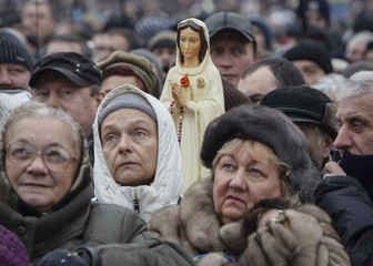 A participant holds a statue of the virgin Mary during a pro-European integration rally at Independence Square in Kiev