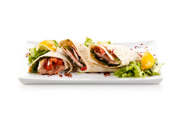Spring rolls - wraps with meat and vegetables on white background