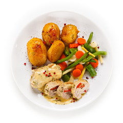 Meatballs with potatoes and vegetables on white background