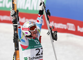 Marion Rolland of France reacts after the women's Downhill race at the World Alpine Skiing Championships in Schladming