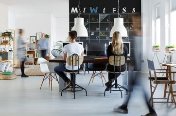 People in modern coworking space