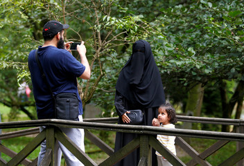 Tourists take pictures at Vrelo Bosne nature park in Ilidza near Sarajevo,