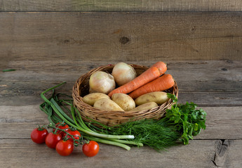 Basket of vegetables on the wood background