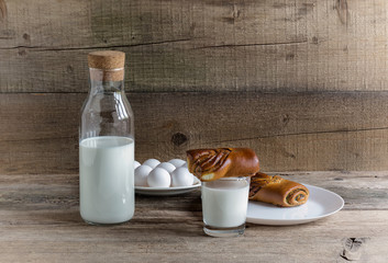 Glass and bottle of milk and biscuit