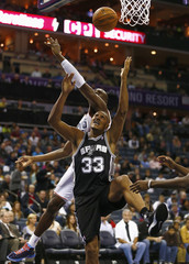 San Antonio Spurs center Diaw of France fights for a rebound against Charlotte Bobcats power forward Biyombo from the Democratic Republic of Congo during an NBA basketball game in Charlotte