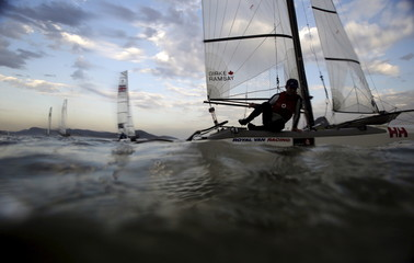 Luke Ramsay, of Canada leaves the Guanabara Bay waters after taking part in Nacra 17 class during the Aquece Rio International Regatta in Rio de Janeiro