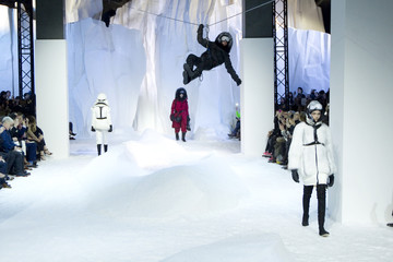Models present creations by Italian designer Valli as part of his Fall-Winter 2013/2014 women's ready-to-wear fashion show for fashion house Moncler Gamme Rouge during Paris fashion week