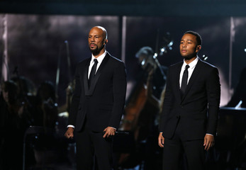 "Common and John Legend stand after performing ""Glory"" from the film ""Selma"" at the 57th annual Grammy Awards in Los Angeles"