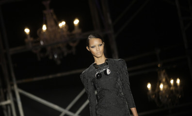 A model presents a creation from Teca's 2010 autumn/winter collection during the Fashion Rio Show in Rio de Janeiro