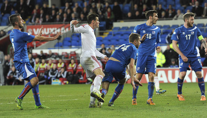 Wales' Gareth Bale scores a goal against Iceland during the friendly international soccer match at Cardiff City Stadium in Cardiff