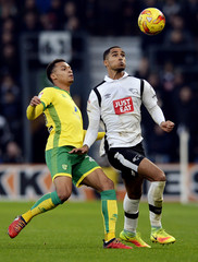 Derby's Max Lowe in action with Norwich's Jacob Murphy
