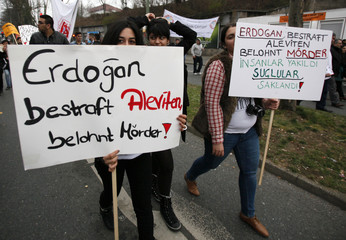 Protesters carry placards during peaceful protest against Turkish Prime Minister Erdogan in Bochum