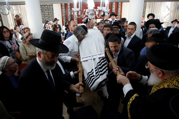Ultra-Orthodox Jewish men carry the body of former Chief Rabbi of France, Joseph Haim Sitruk, during his funeral in Jerusalem