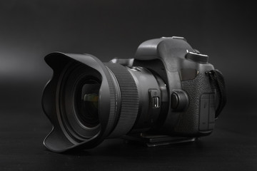 GOMEL, BELARUS - May 12, 2017: Canon 6d camera with lens on a black background. Canon is the world's largest SLR camera manufacturer.