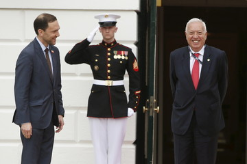 U.S. Chief of Protocol Ambassador Selfridge greets Spanish Foreign Minister Garcia-Margallo as they arrive for a working dinner with heads of delegations for the Nuclear Security Summit at the White House in Washington