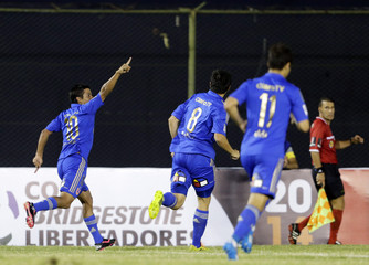 Ramon Ignacio Fernandez of Chile's Universidad de Chile celebrates a goal with teammates Rodrigo Mora and Rodrigo Rojas during their Copa Libertadores soccer match against Paraguay's Guarani in Asuncion