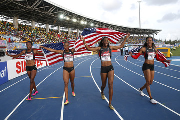 The U.S. women's 4x400 metres relay team takes a victory lap after winning their event during the IAAF World Relays Championships in Nassau