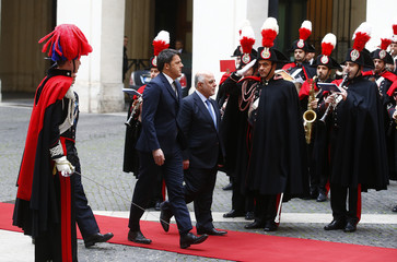 Italian Prime Minister Renzi and his Iraqi counterpart Haider Al-Abadi review the honour guard during a meeting at Chigi Palace in Rome