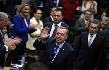 Turkey's Prime Minister Tayyip Erdogan greets members of parliament from his ruling AK Party as he arrives a meeting at the Turkish parliament in Ankara