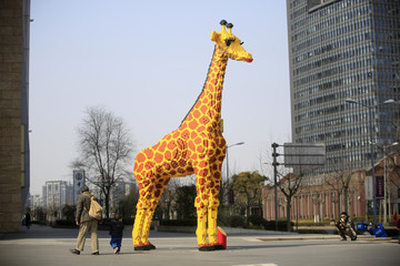 A 6.16-meter tall Lego giraffe is seen next to a shopping mall in Shanghai