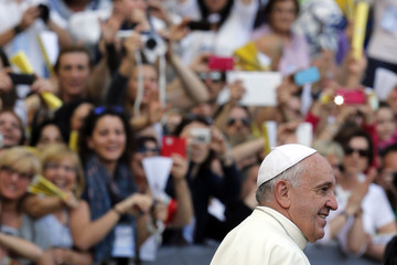 Pope Francis arrives for a meeting of the Renewal of the Holy Spirit organization at the Olympic stadium in Rome