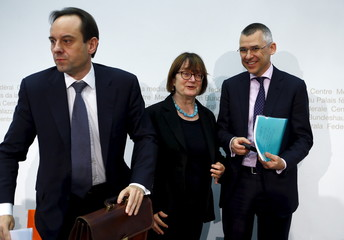 Swiss Financial Market Supervisory Authority Director Mark Branson, FINMA President Anne Heritier Lachat and FINMA Vice Director Peter Giger leave a news conference in Bern