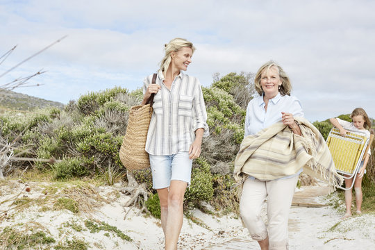 Mother, daughter and grandmother spending a day at the beach