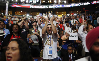 A Bernie Sanders supporter screams during the Convention Rules Committee report at the start of the first session at the Democratic National Convention in Philadelphia