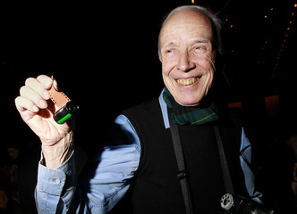 New York Times photographer Bill Cunningham poses for a portrait with a roll of film in his hand during the Fall 2010 collections during New York Fashion Week