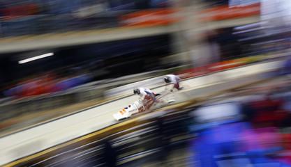 """Latvia's Oskars Melbardis and Daumants Dreiskens run at the start of their two-men bobsleigh test event at the """"Sanki"""" sliding center in Rosa Khutor"""