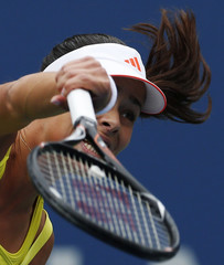 Ivanovic of Serbia serves to Pironkova of Bulgaria during their women's singles match at the U.S. Open tennis tournament in New York