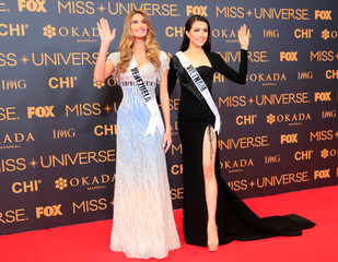 Miss Universe candidates Mariam Habach of Venezuela and Dang Thi Le Hang of Vietnam pose for a picture during a red carpet inside a SMX convention in metro Manila