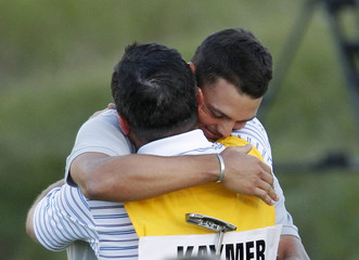 Kaymer of Germany is congratulated by his caddy after winning the 92nd PGA Golf Championship at Whistling Straits