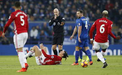 Manchester United's Zlatan Ibrahimovic lies injured as referee Anthony Taylor looks on