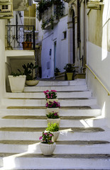 Narrow street in romantic white city of Ostuni, Puglia, Italy