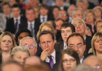 Britain's Prime Minister David Cameron listens to speeches at the Conservative Party annual conference in Birmingham