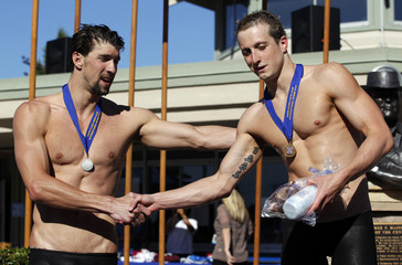 Phelps shakes hands with first place winner D'Arcy in the men's 200m butterfly final race at the Santa Clara International Grand Prix swim competition in Santa Clara