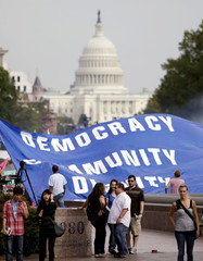 A banner of the Occupy D.C camp is seen with the U.S. Capitol in the background in Washington