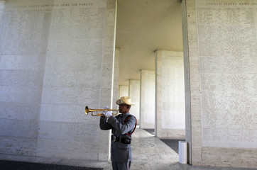 A member of the Philippine Army plays the trumpet during a Memorial Day ceremony in Manila