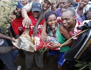 Supporters of Kenyan presidential candidate Uhuru Kenyatta celebrate on the outskirts of Nairobi