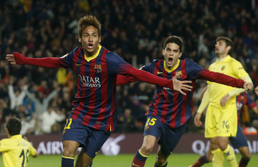 Barcelona's soccer player Neymar and Bartra celebrate a goal against Villarreal during their Spanish First division League soccer match at Camp Nou stadium in Barcelona