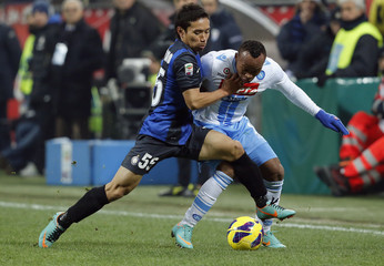 Inter Milan's Nagatomo challenges Zuniga of Napoli during their Serie A soccer match at San Siro stadium in Milan