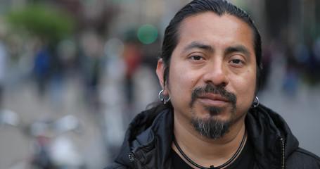 Hispanic Latino man in city face portrait