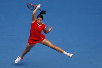 McHale of the U.S. hits a return to Jankovic of Serbia during their women's singles match at the Australian Open tennis tournament in Melbourne
