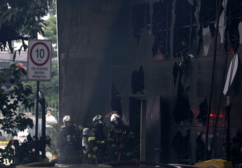 Firefighters attempt to control a fire at the Latin America Memorial in Sao Paulo