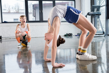 funny kids in sportswear training at fitness studio together, children sport concept
