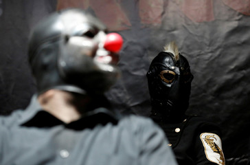"Slipknot members Crahan and Wilson attend a news conference to announce ""Ozzfest Meets Knotfest"" music festival at the Hollywood Palladium in Los Angeles"
