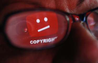 A picture illustration shows a YouTube error logo reflected in a person's eye, in central Bosnian town of Zenica